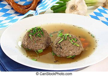 Liver dumpling soup - a plate of liver dumpling soup with...
