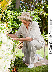 Mature woman working in her garden