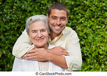 Man hugging his mother in the garden
