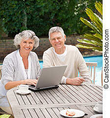 Retired couple working on their laptop