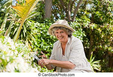Pretty senior woman looking at the camera