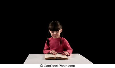 reading girl on black background