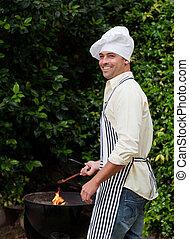 Man having a barbecue in the garden