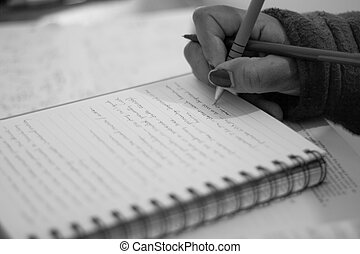 Taking notes - A student taking notes