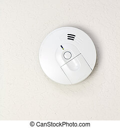 Smoke Alarm - Small round battery operated device to warn...