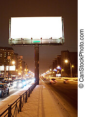 Big white billboard on the night street