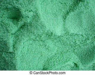 large amount of green bath salt with scoop holes in it