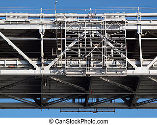 Close up of San Francisco Bay Bridge middle section of double deck roadway on a clear blue day.
