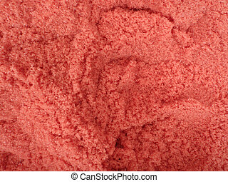 large amount of red bath salt with scoop holes in it