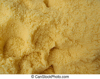 large amount of yellow bath salt with scoop holes in it