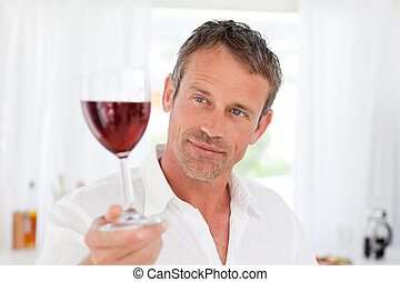 Man with his wineglass in his kitch
