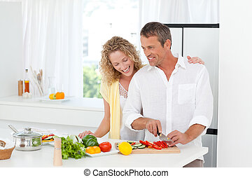 Couple cooking together in their kitchen