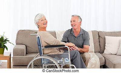 Man with his wife in a wheelchair
