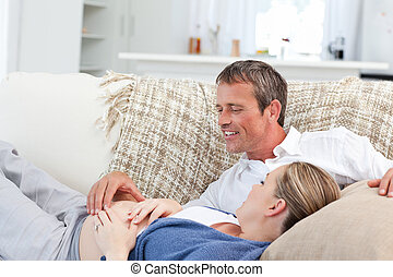 Couple lying down on the couch