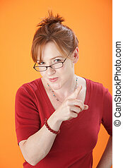 Woman points her finger - Caucasian lady with glasses...