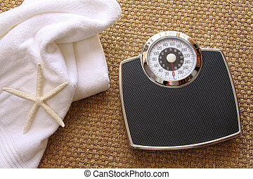 Weight scale with towel on carpet - Weight scale with white...