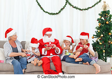 Santa Claus with a happy family