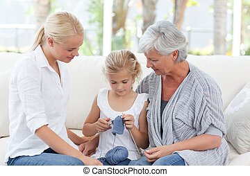 Family knitting together at home