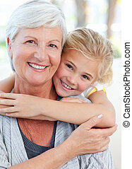 Lovely little girl with her grandmother looking at the...
