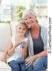 Senior with her granddaughter looking at the camera