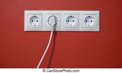 Man unplug and push electric plug - Closeup of electrical...
