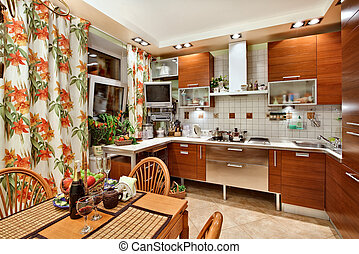 Kitchen interior with wooden furniture, table and many...