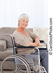 Woman looking at the camera in her wheelchair