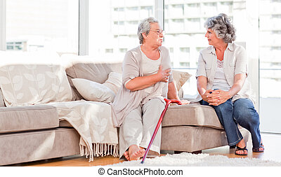 Mature friends talking on the sofa