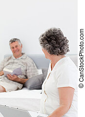 Woman talking with her husband at home