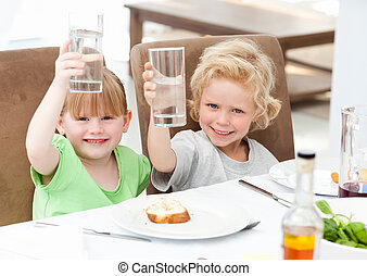 Children toasting with their drink