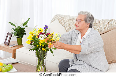 Senior woman with flowers  - Senior with flowers  at home