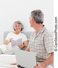 Man talking with his wife at home