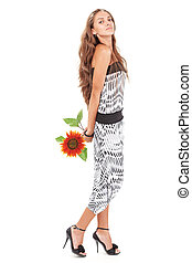 Young beautiful lady in harem pants with sunflower full-length studio portrait on white