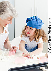 A little girl  baking with her gran