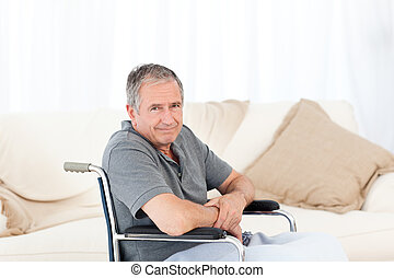 Retired man in his wheelchair at home