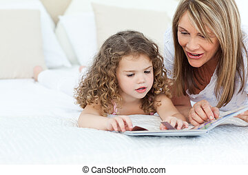 Young girl reading a book with her