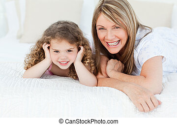Little girl with her grandmother looking at the camera