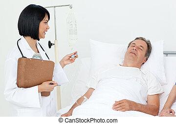 Nurse with a couple in a hospital