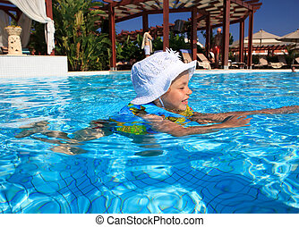 Little girl in the pool.