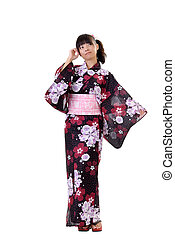 Young japanese girl in traditional clothes, full length...