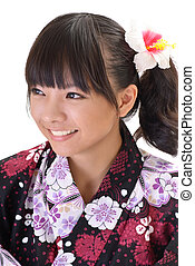 Happy Japaneses girl with cheerful expression and smiling on...