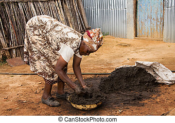 african woman working - elderly african woman preparing a...