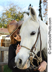 Cowgirl petting her horse - Cowgril petting her beautiful...