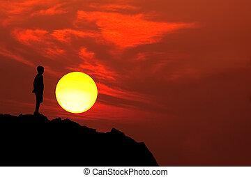 boy mountain silhouette - adolescent boy silhouette on...
