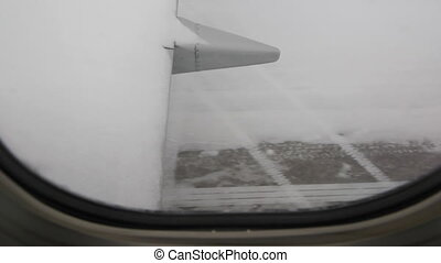 Jet taxiing on winter runway - View through passenger window...