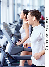 People in fitness club - Young attractive people in the...
