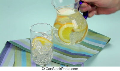 Orange Punch - Pouring a refreshing glass of orange punch to...