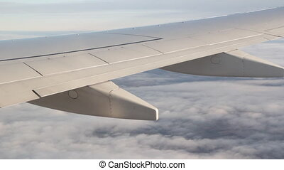 Jet banking to blue sky - Detail of commercial pssenger jet...