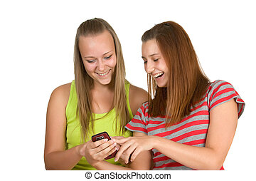 Portrait of lovely young women using mobile phone together...