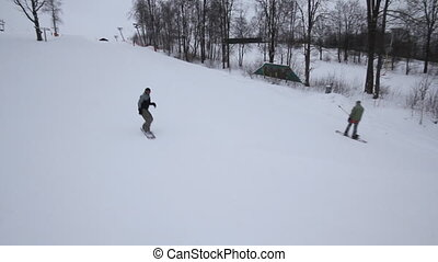 snowboarder jumping - snowboarder slides from the mountain...